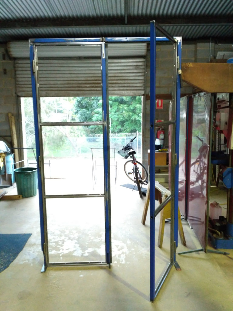 steel glass industrial doors bangalow being made